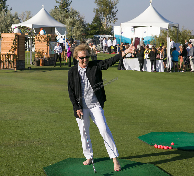 Karen Weil celebrates after hitting the green by chipping to try to win a $500 gift certificate from Scheels during the Art of Childhood Gala and Fundraiser at Montreux Golf and Country Club on Friday, August 24, 2018.