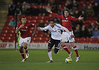 Pictured: Ashley Williams of Swansea (C) marked by L-R Craig Davies and Andy Gray of Barnsley. Saturday 07 January 2012<br /> Re: FA Cup football Barnsley FC v Swansea City FC at the Oakwell Stadium, south Yorkshire.