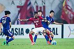 Guangzhou Midfielder Paulinho Maciel (C) in action against Suwon Midfielder Kim Jongwoo (R) during the AFC Champions League 2017 Group G match between Guangzhou Evergrande FC (CHN) vs Suwon Samsung Bluewings (KOR) at the Tianhe Stadium on 09 May 2017 in Guangzhou, China. Photo by Yu Chun Christopher Wong / Power Sport Images