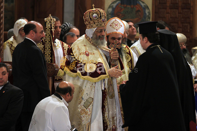 Coptic Pope Tawadros II, swings an incense burner during Christmas Eve Mass at Cairo s St. Mark s Cathedral, seat of the Coptic Orthodox Pope, in Cairo, Egypt, Monday Jan. 6, 2014. Millions of Egyptian Christians on Monday thronged churches across the mainly Muslim nation for Christmas Mass, held amid unusually tight security but with congregations filled with hope ahead of a key vote this month on constitutional amendments that enshrine equality and criminalize all types of discrimination. Photo by Mohammed Bendari