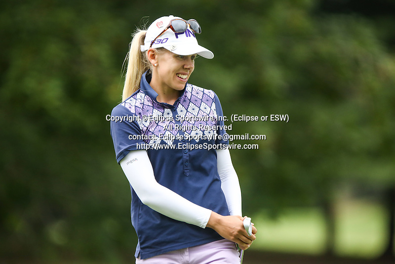 Pernilla Lindber watches her putt on the 8th hole at the LPGA Championship 2014 Sponsored By Wegmans at Monroe Golf Club in Pittsford, New York on August 16, 2014