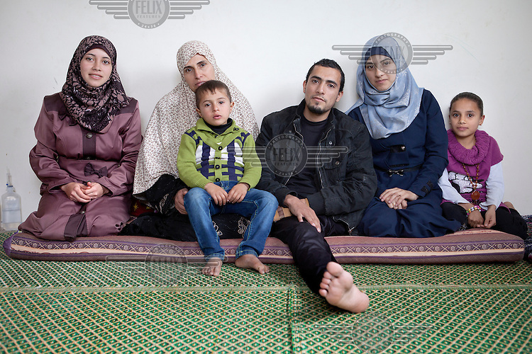 24 year old Abdullah Abu Harbeed, from Biet Hanoun, at home with his family. He sustained explosive injuries and lost his left leg in the Israeli summer offensive on Gaza. His injuries were so severe that he would have died without the reconstructive surgeries he underwent in the months following his initial surgery. <br /> <br /> On 7 July 2014, Israeli forces launched a large-scale military operation ('Pillar of Defense') in the Gaza Strip). The operation lasted 51 days and resulted in 2,145 deaths and 11,231 injuries among the Palestinian population. The vast majority of the serious casualties have complex orthopaedic injuries that the Palestinian Ministry of Health is ill-equiped to manage. DFID/UK Aid is funding NHS Doctors, deployed through the UK's Rapid Response Facility's funding, to work alongside Medical Aid for Palestinians (MAP) in providing post conflict surgery at Gaza's Shifa Hospital. The NHS doctors (through the charity Ideals) volunteer to visit Gaza in their spare time and work alongside their Palestinian colleagues.
