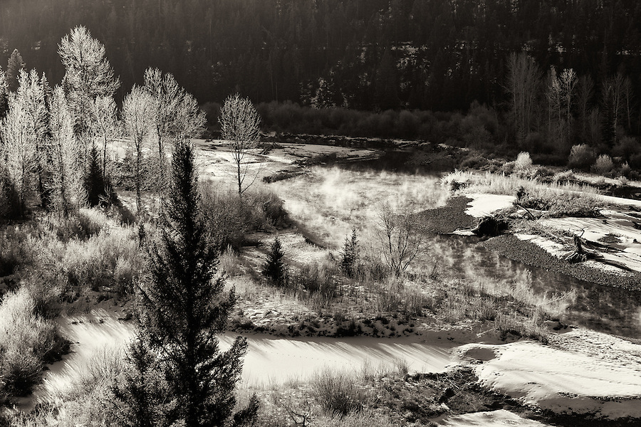Frost covers the vegetation near a small river in Montana.