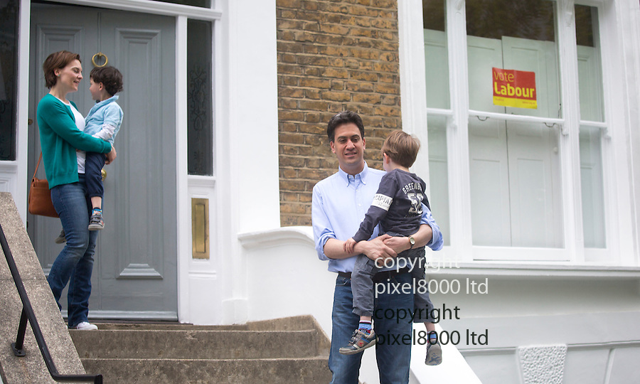 Pic shows: Day after quitting at his home in North London<br /> <br /> Ed Milliband with wife Justine and children Daniel and Samuel  - posed for photographers putting a brave face on things.<br /> Vote Labour poster still in the window\<br /> <br /> Asked if he has a good night's sleep Ed replied &quot;yeah, not too bad.&quot;<br /> <br /> They were temporarily locked out of the house as they tried to get back inside and had to ring the doorbell<br /> <br /> <br /> <br /> Pic by Gavin Rodgers/Pixel 8000 Ltd