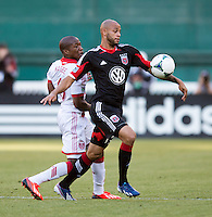 Kyle Porter (19) of D.C. United fights past Darlington Nagbe (6) of the Portland Timbers during a Major League Soccer match at RFK Stadium in Washington, DC.  The Portland Timbers defeated D.C. United, 2-0.