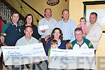 Michael McCarthy finance officer for Legion GAA club presents the winner of the club lotto Joanne Twomey a cheque for EUR6000 in Murphy's bar Killarney Friday evening front row l-r: Peter O'Leary, Maeve O'Sullivan-Darcy, Michael McCarthy. Back row: Pat Kissane, Marian O'Connor, Liam O'Connor (winner of two All Ireland tickets), Sean Murphy, John and Rachel O'Sullivan-Darcy...