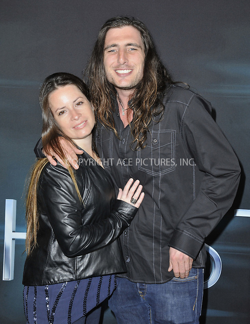 WWW.ACEPIXS.COM....March 19 2013, LA....Holly Marie Combs and guestl arriving at the 'The Host' Los Angeles premiere at the ArcLight Cinemas Cinerama Dome on March 19, 2013 in Hollywood, California. ....By Line: Peter West/ACE Pictures......ACE Pictures, Inc...tel: 646 769 0430..Email: info@acepixs.com..www.acepixs.com