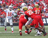 *Ohio State Buckeyes quarterback J.T. Barrett (16) faces little defensive pressure as a gets a pass off against Maryland in second half action at Byrd Stadium on October 4, 2014.  (Chris Russell/Dispatch Photo)