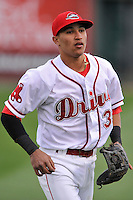 Shortstop Jeremy Rivera (35) of the Greenville Drive warms up before a game against the Asheville Tourists on Thursday, April 7, 2016, at Fluor Field at the West End in Greenville, South Carolina. Greenville won, 4-3. (Tom Priddy/Four Seam Images)