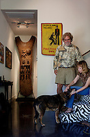 Los Angeles, California, November 14, 2009 - Ernie and Diane Wolfe play with their dog Malaika in their home, based on a Quonset hut. The Wolfe's own the Ernie Wolfe Gallery and are the most reknowned African at dealers in the country. ..CREDIT: Daryl Peveto/LUCEO for The Wall Street Journal.Homefront - Ernie Wolfe #1348.