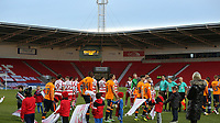 Both teams come to the pitch ahead of Sky Bet League 1 match between Doncaster Rovers and Oldham Athletic at the Keepmoat Stadium, Doncaster, England on 16 December 2017. Photo by Juel Miah / PRiME Media Images.