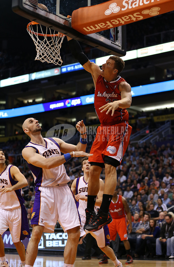 Jan. 24, 2013; Phoenix, AZ, USA: Los Angeles Clippers forward Blake Griffin (32) attempts to dunk the ball over Phoenix Suns center Marcin Gortat in the first half at the US Airways Center. Mandatory Credit: Mark J. Rebilas-USA TODAY Sports