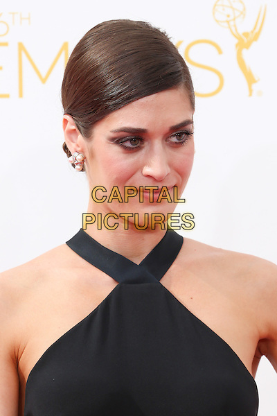 LOS ANGELES, CA - AUGUST 25: Lizzy Caplan at The 66th Primetime Emmy Awards held at Nokia Theater L.A. LIVE in Los Angeles, CA on August 25, 2014.  <br /> CAP/MPI/mpi99<br /> &copy;mpi99/MediaPunch/Capital Pictures