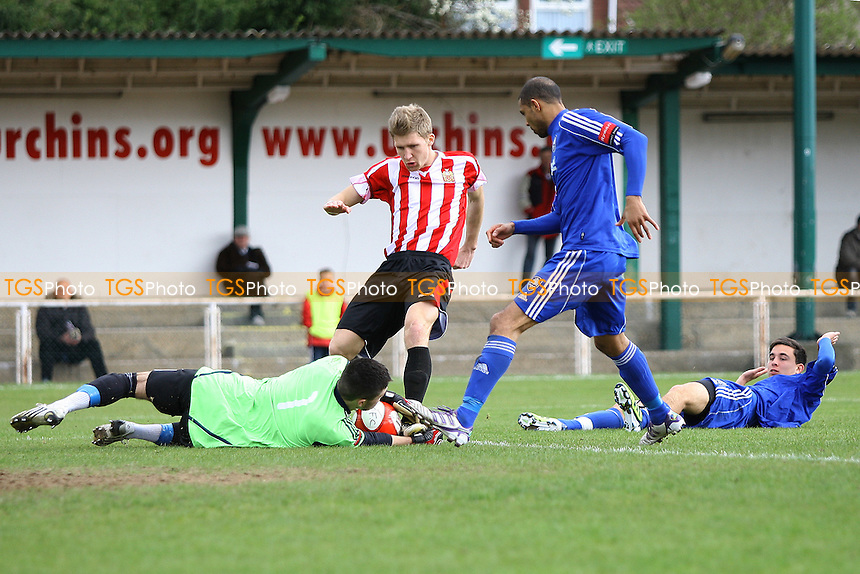 Jamie Butler smothers the ball from Lewis Smith of Hornchurch- AFC Hornchurch vs Metropolitan Police - Ryman League Premier Division Football at The Stadium - 31/03/12 - MANDATORY CREDIT: George Phillipou/TGSPHOTO - Self billing applies where appropriate - 0845 094 6026 - contact@tgsphoto.co.uk - NO UNPAID USE.