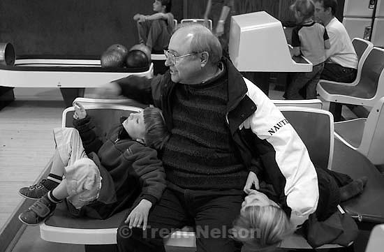 Noah Nelson, Nathaniel Nelson, Steve Nelson, Ed Zambrano bowling at BYU. 12/08/2001, 12:59:30 PM<br />