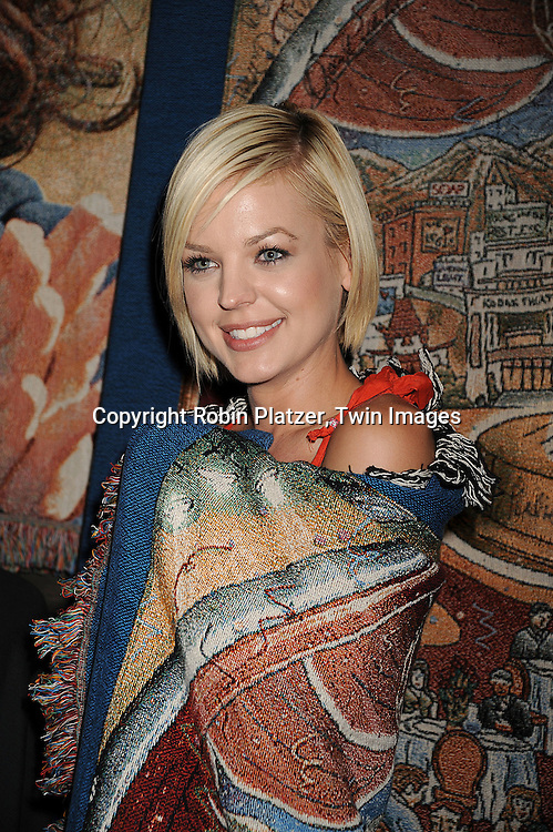Kirsten Storms wearing a TreasureKnit blanket of The 35th Annual Daytime Emmy Awards poster by Charles Fazzino..atThe Official Talent Gift Lounge at The 35th Annual Daytime Emmy Awards backstage at The Kodak Theatre on June 19, 2008 in Hollywood, California. ....Robin Platzer, Twin Images