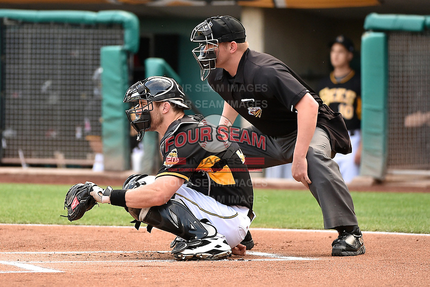 John Hester (22) of the Salt Lake Bees behind the plate with home plate umpire Brandon Hensen during the game against the El Paso Chihuahuas in Pacific Coast League action at Smith's Ballpark on August 7, 2014 in Salt Lake City, Utah.  (Stephen Smith/Four Seam Images)