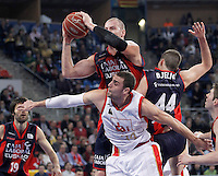 Caja Laboral Baskonia's Maciej Lampe (l) and Nemanja Bjelica (r) and CAI Zaragoza's Pablo Aguilar during Spanish Basketball King's Cup match.February 07,2013. (ALTERPHOTOS/Acero)