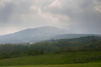 A view over the mountains in the Saint Joseph wine district near the village of Malleval. Dark cloads and rain and some rays of sunshine.  Domaine Pierre Gaillard, Malleval, Ardeche, ardèche, France, Europe