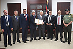 Palestinian President Mahmoud Abbas receives the annual report of the Retirement Authority, in the West Bank city of Ramallah, on June 22, 2017. Photo by Osama Falah