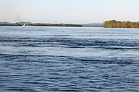 A barge chugs down the swollen Mississippi River near Cape Rock Park in Cape Girardeau, MO, on Wednesday, May 4, 2011.