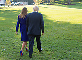 United States President Donald J. Trump and first lady Melania Trump walk on the South Lawn as they depart the White House in Washington, DC, November 3, 2017 for a multi-day trip to Hawaii and then on to Asia. <br /> Credit: Chris Kleponis / CNP