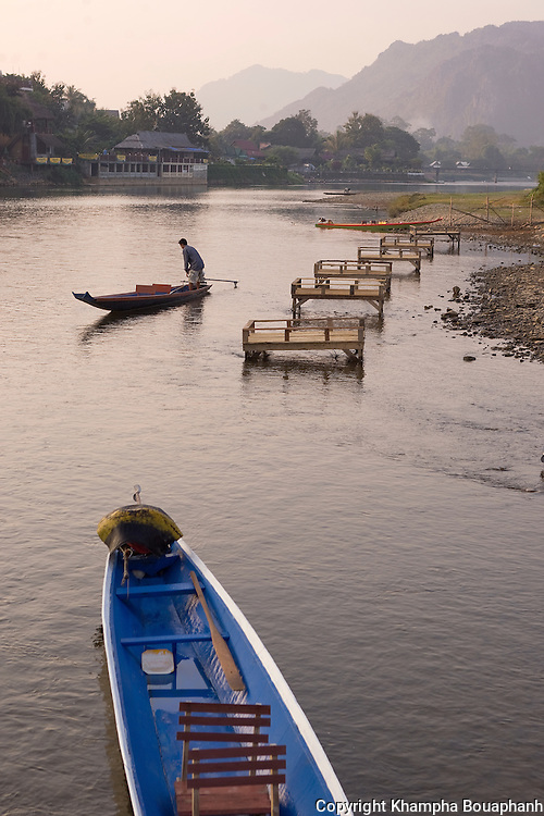 A boat man starts off his day on Nam Song in Vang Vieng, Laos on November 4, 2009.   (Photo by Khampha Bouaphanh)