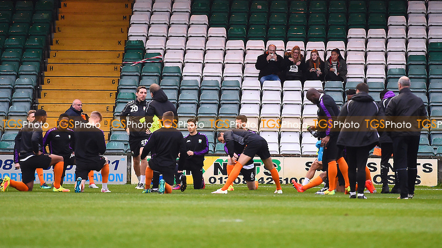Barnet players warm up in front of the away fans during Yeovil Town vs Barnet, Sky Bet EFL League 2 Football at Huish Park on 10th December 2016