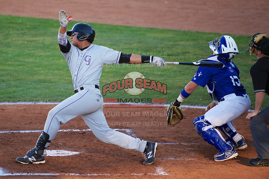 Grand Junction Rockies Jose Briceno #35 follows through on his swing against the Ogden Raptors at Lindquist Field on June 27, 2013 in Ogden, Utah. (Stephen Smith/Four Seam Images)