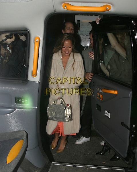 "JADE JAGGER & GUEST.""Get Rich Or Die Tryin'"" - UK film premiere afterparty at Tantra, London, UK..January 17th, 2006.Ref: AH.full length white fur coat car cab taxi silver purse bag.www.capitalpictures.com.sales@capitalpictures.com.© Capital Pictures."