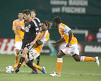 Branko Boskovic #27 of D.C. United is tackled by Joseph Ngwenya #33 of the Houston Dynamo during an MLS match at RFK Stadium in Washington D.C. on September  25 2010. Houston won 3-1.