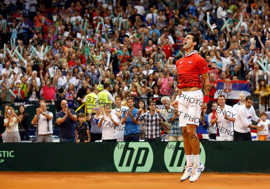 Tennis Tenis<br /> Davis Cup semifinal polufinale<br /> Serbia v Canada<br /> Novak Djokovic v Milos Raonic<br /> Novak Djokovic reacts<br /> Beograd, 15.09.2013.<br /> foto: Srdjan Stevanovic/Starsportphoto &copy;