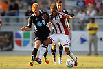 05 June 2012: Chivas USA's Juan Agudelo (11) is defended by Carolina's Cory Elenio (left) and Brian Shriver (behind). The Carolina RailHawks (NASL) lost 1-2 to Club Deportivo Chivas USA (MLS) at WakeMed Soccer Stadium in Cary, NC in a 2012 Lamar Hunt U.S. Open Cup fourth round game.