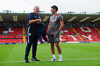 Lincoln City manager Danny Cowley, left, speaks to Sheffield Wednesday's manager Steve Bruce prior to the game<br /> <br /> Photographer Chris Vaughan/CameraSport<br /> <br /> Football Pre-Season Friendly - Lincoln City v Sheffield Wednesday - Saturday July 13th 2019 - Sincil Bank - Lincoln<br /> <br /> World Copyright © 2019 CameraSport. All rights reserved. 43 Linden Ave. Countesthorpe. Leicester. England. LE8 5PG - Tel: +44 (0) 116 277 4147 - admin@camerasport.com - www.camerasport.com