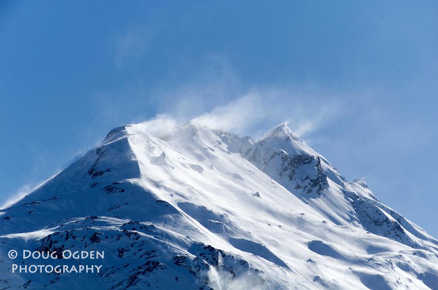 Wind blowing off jagged mountain peak, near Valdez, Alaska