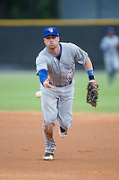 Bluefield Blue Jays first baseman Levi Scott (34) flips the ball towards first base during the game against the Burlington Royals at Burlington Athletic Stadium on June 27, 2016 in Burlington, North Carolina.  The Royals defeated the Blue Jays 9-4.  (Brian Westerholt/Four Seam Images)
