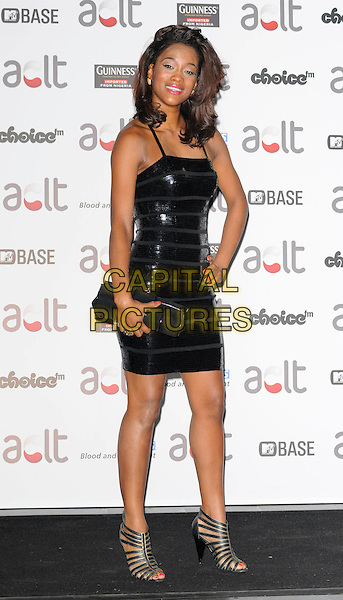 TIANA BENJAMIN .Afro Caribbean Leukaemia Trust Gift Of Life Ball at the Inter-Continental Hotel, Park Lane, London, England, September 20th 2008..full length tight black mini dress clutch bag shoes sandals shiny hand on hip.CAP/CAN.©Can Nguyen/Capital Pictures