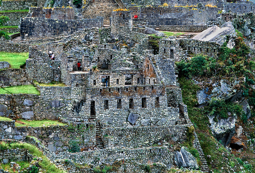 Tourists exploring the ruins at Machu Picchu in Peru.