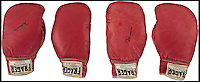 BNPS.co.uk (01202 558833)<br /> Pic: Heritage/BNPS<br /> <br /> Ali has signed both pairs.<br /> <br /> The gloves are off...Heavyweight tussle expected for &pound;350,000 gloves.<br /> <br /> For sale - the gloves worn by Ali and Liston in the famous 1965 &ldquo;Phantom Punch&rdquo; bout in Lewiston, Maine. - the most controversial sports event in history <br /> <br /> The gloves have been consigned by Los Angeles collector Seth Ersoff, who acquired the pair from the family of the boxing commissioner for the state of Maine in 1965, who seized the gloves at the bout&rsquo;s scandalous end &ndash; Ali&rsquo;s &ldquo;Phantom Punch&rdquo; &ndash; just under two minutes into the first round.<br /> <br /> Speculation as to whether Liston was made to take a dive by his underworld connections continues to this day, making the fight one of the most controversial in history.<br /> <br /> New York - Heritage - 21st Feb - &pound;350,000