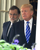 United States President Donald J. Trump, right, and President of the Government or Prime Minister Mariano Rajoy of Spain, left, depart the Oval Office to conduct a joint press conference in the Rose Garden of the White House in Washington, DC on Tuesday, September 26, 2017.<br /> Credit: Ron Sachs / CNP