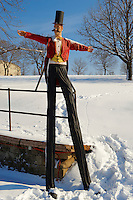 Clown on stilts at the Citadel in the snow . Budapest, Hungary