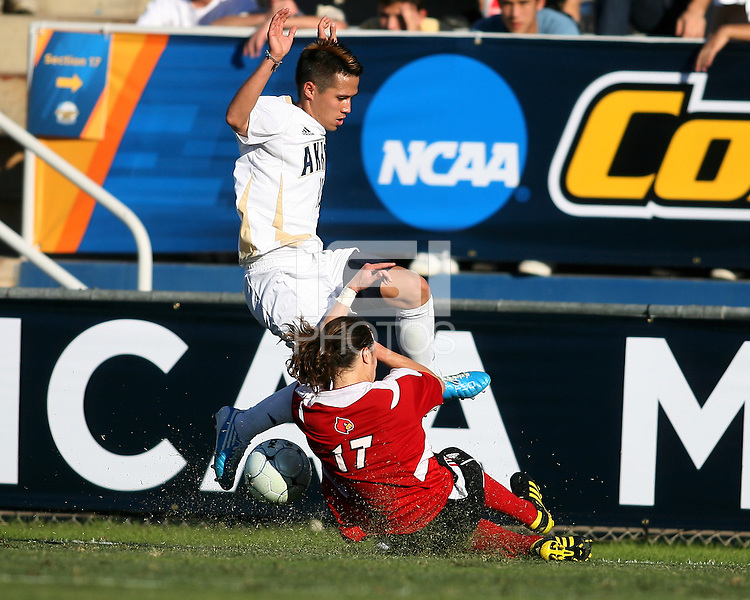 Anthony Ampaipaitakwong #10 of the University of Akron is tackled by Brock Granger #17 of the University of Louisville during the 2010 College Cup final at Harder Stadium, on December 12 2010, in Santa Barbara, California.Akron champions, 1-0.