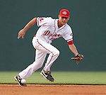 Shortstop Derrik Gibson (18) tracks down a ground ball during Spartanburg Night with the Greenville Drive on June 8, 2010, at Fluor Field at the West End in Greenville, S.C. Photo by: Tom Priddy/Four Seam Images
