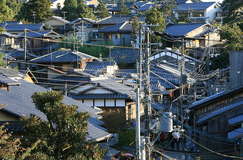 Houses on a typical street in Kyoto, Japan, on November 7, 2006. Kyoto is the former imperial capital of Japan, and today houses more than 1.5 million. Photo by Lucas Schifres/Pictobank