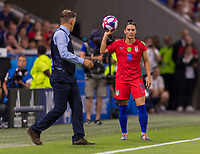 LYON,  - JULY 2: Ali Krieger #11 throws the ball in during a game between England and USWNT at Stade de Lyon on July 2, 2019 in Lyon, France.