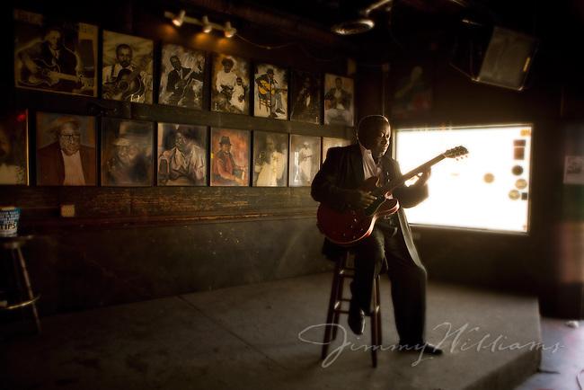 Blues Musician Albert White plays his guitar in a local Atlanta bar.