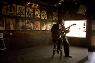 Blues Musician Albert White plays his guitar in a local Atlanta bar.