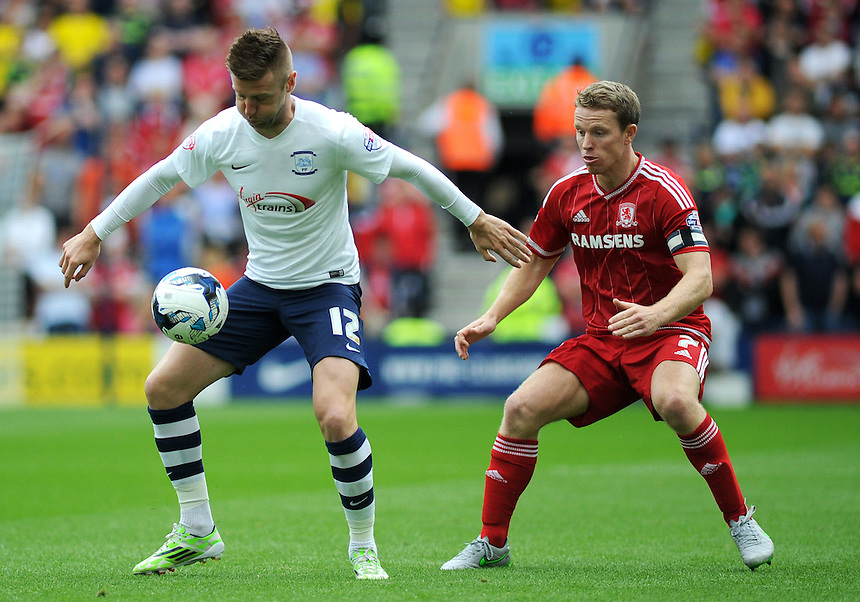 Preston North End's Paul Gallagher under pressure from Middlesbrough's Grant Leadbitter<br /> <br /> Photographer Kevin Barnes/CameraSport<br /> <br /> Football - The Football League Sky Bet Championship - Preston North End v Middlesbrough -  Sunday 9th August 2015 - Deepdale - Preston<br /> <br /> &copy; CameraSport - 43 Linden Ave. Countesthorpe. Leicester. England. LE8 5PG - Tel: +44 (0) 116 277 4147 - admin@camerasport.com - www.camerasport.com