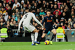 Real Madrid's Raphael Varane and Valencia CF's Kevin Gameiro during La Liga match between Real Madrid and Valencia CF at Santiago Bernabeu Stadium in Madrid, Spain. December 01, 2018. (ALTERPHOTOS/A. Perez Meca)