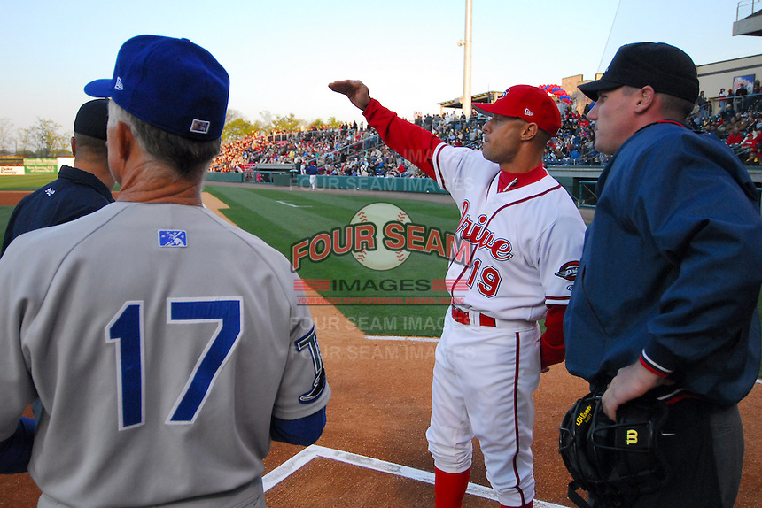 Greenville Drive manager Gabe Kapler exchanges lineup cards with the umpires and Columbus Catfish manager Jim Morrison before the Drive's first home game of the year Monday, April 9, 2007, in Greenville, South Carolina. Kapler is a former player for the Boston Red Sox. (Tom Priddy/Four Seam Images)